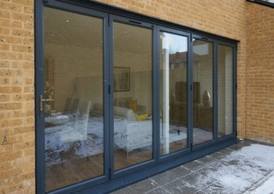 Grey Bi-folding Doors - Orchard Stamford