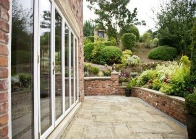 White Bi-Folding - Orchard Home Improvements Stamford